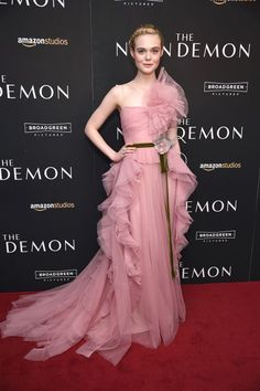 For the premiere of her new film, The Neon Demon, Elle Fanning stunned in yet another perfect outfit. This frilly pink Gucci gown was pretty much made for the bubbly actress.