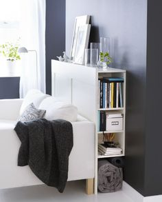 A headboard in the living room? Why not! Slip it behind the sofa for some smart semi-hidden storage.