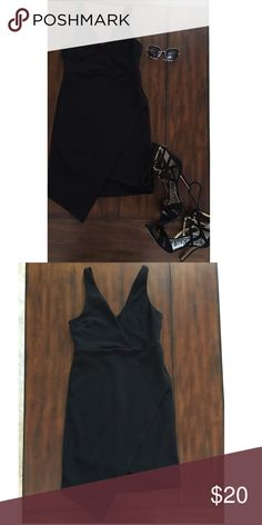 Black asymmetrical dress Black stretchy crepe asymmetrical dress . Good condition no stains or loose strings. Leith Dresses Mini