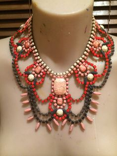 This piece packs a serious punch! The result of expereimentation with colour palettes, it is so surprising that these colours work together but they just do! #statementnecklace #bibnecklace #neutraltones