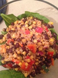 Southwest Quinoa Salad- quinoa, black beans, corn, red pepper, red onion, cucumber with lime juice, vinegar, olive oil, chilli powder. Served over a bed of spinach