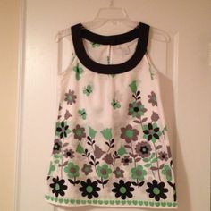 Flower Sleeveless Top Adorable sleeveless top with a lovely bright pattern. Charlotte Russe Tops