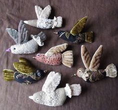 pretty migration a tiny embroidered flock of bird brooches to inspire you in your gift making of textile jewelry folk art boho style fabric scrap project Елена Пинталь Textile Jewelry, Fabric Jewelry, Textile Art, Fabric Birds, Fabric Art, Fabric Scraps, Scrap Fabric Projects, Sewing Projects, Art Projects