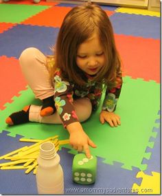 role dice, count dots, and put that many sticks in jar