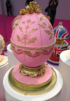 This faberge egg is really CAKE.   Cupcake Oven's pink, green and gold cake was made using a special cake enamelling technique,  royal icing piping, and golden sugar roses