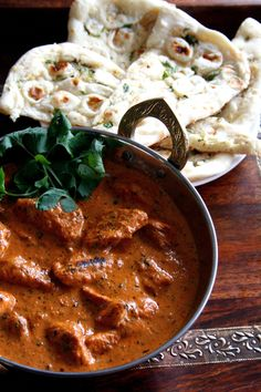 [ Recipe: Chicken Tikka Masala ] Marinade is made with chicken, yogurt, cumin powder, turmeric powder, garlic, salt, and chili powder. The sauce is made with onion, red bell pepper, cashews, coriander powder, cloves, kasoori methi (dried fenugreek leaves), cream, tomato ketchup, butter, oil, chili powder, salt, and cilantro for garnish.