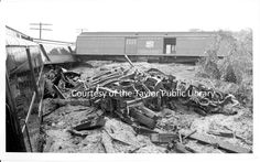 Train wreck at Weir:  Missouri-Kansas-Texas cars derailed with pile of wreckage in the foreground.  October 14, 1957. 04-2016