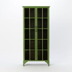 An iron cabinet... with glass door fronts... in an amazing shade of green?  LOVE.  Terrain Iron & Glass Tall Cabinet, at Terrain.
