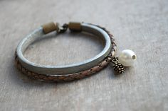 "winter mood  """"  braided leather bracelet // boho elegant // silver grey white brown. €17,90, via Etsy."