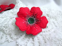 Textile brooch  Red Poppy  Red poppy felt and fabric brooch.  Free hand machine embroidered and hand painted flower brooch. Felt and fabric brooch based on filz imparting a convex shape and density.  Safety pin on the back side. Brooch will bring good luck and emphasize the originality of the its owners image. Jewelry with a soul. Inspired by nature. Made with love. Measures: 7 x 7 cm / 2,8 x 2,8 inch  6 x6 cm /2,4 x2,4 inch  Real colors may slightly differ from displaying on different…