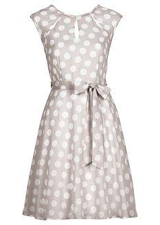 Elegantné šaty od Bodyflirt v modernom bodkovanom štýle. Výnimočným detailom je dierkovanie na výstrihu, s pásom na prednej aj zadnej strane na zaviazanie. Veľkosť vo veľ. 38 cca 90 cm. Vrchný materiál: 100% polyester; Podšívka: 100% polyester