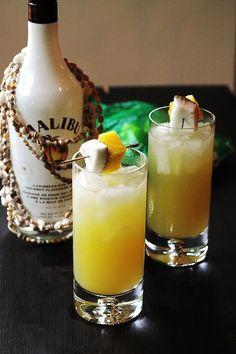 Coconut Pineapple Rum Drink.  1½ oz white rum ½ oz Malibu 1 oz coconut Water 3 oz pinapple juice ½ - 1 Lime juiced Splash of soda