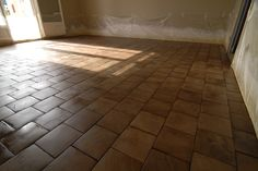 End cut oak parquet wood floor. This french website has the most beautiful wood floors and tips on installation. I think I could do this