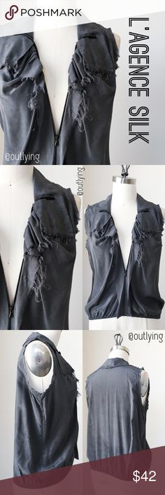 """L'AGENCE Silk Tank L'AGENCE Silk Blousant Zipper Raw Ruffle Tank Retail Price: $269 NWOT / Never Worn Sample Size: S Color: Grey Washout Length: 20-22"""" Bust 37"""" Waist 26-40"""" (elastic hem)  Raw edged beauty with moody ruffles, hard edged zipper front for an adjustable plunge neckline or more conservative for work, soft drape collar, and overdyed grey wash color for a handmade effect. Pair with your fave cigarette pants or pencil skirt for work or night out ready with skinny jeans and…"""