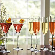 Make-ahead cocktails in lively colors can be pre-poured and arranged buffet style so as to look very inviting and make your guests feel at home. The Lenox Tuscany Classics Stemware is a perfect fit for any décor especially for summer parties!