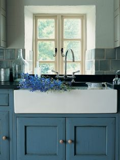 Farm sink in cream + contrasting color cabinet in blue | kitchen colors | Twig Hutchinson