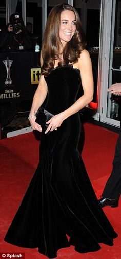 Kate wears Alexander McQueen again, this time in black. There's nothing like a black velvet dress for the holidays.