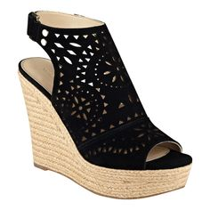The Harlea is a laser cut design outlines this espadrille wedge sandal with jute sidewalls.