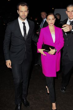 Miss Dior exhibition preview, Paris - November 12 2013  Natalie Portman - in a Dior pink coat - with husband Benjamin Millepied.