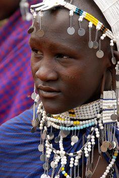 Africa | Portrait of a young Masai girl.  Tanzania | © Jean-Christophe Huet.