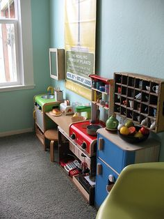 A sweet corner of a child's room... A whole play kitchen! I especially love the cup storage
