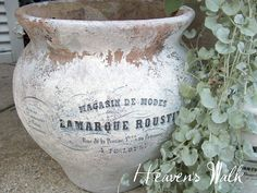 "Clay pot ""aged"" with paint and labeled using the mod podge technique"