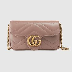 Shop the GG Marmont matelassé leather super mini bag by Gucci. The GG  Marmont mini 16fa32bb8ae