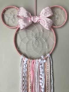 Pink Minnie Mouse Dreamcatcher with bow. Any little Disney princess will love this Minnie Dreamer in her room. Handcrafted with different textures of fibres and ribbon. 13 across and 25 long. Minnie Mouse Stickers, Minnie Mouse Cookies, Minnie Mouse Costume, Minnie Mouse Pink, Mickey Minnie Mouse, Disney Mickey, Little Disney Princess, Princess Sofia, Dream Catcher Decor