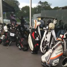 Bags lined up outside the clubhouse sign of a weather delay. Going to be a long day #golf #caddie #tourlife #worldclassic