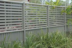 Clik'n'Fit Colorbond steel slat and sheet fence panel.
