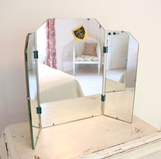 Vintage tri-fold vanity mirror. Soon to be mine!