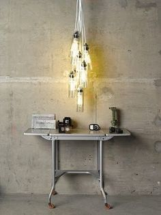 up-cycle glass water bottles - Cheers! Bottle Chandelier, Chandelier Lighting, Chandeliers, Glass Water Bottle, Glass Bottles, Wine Bottles, Diy Hanging, Hanging Lights, Wine And Beer