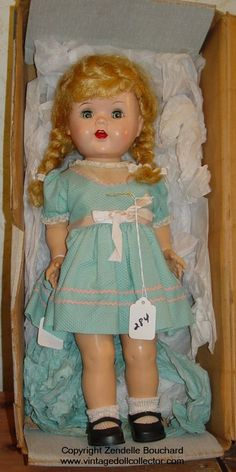 """Saucy Walker is an all hard plastic walking doll with flirty sleep eyes. She was made in 16"""" (pictured at left) and 22"""" sizes and sold in a variety of dresses. She was very popular and was made from 1951 to 1955. There were many knockoffs of Saucy Walker made, these will not have the Ideal marking. In 1955 a vinyl head version of Saucy was made."""