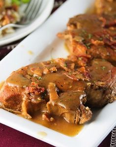 Slow Cooker Smothered Pork Chops from Center Cut Cook, pork chops with bacon and gravy, sounds amazing!
