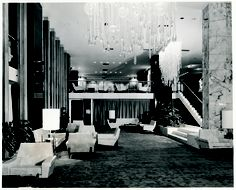 The Mandarin Lobby looking towards the Clipper Lounge. The furniture was chic and contemporary for its time and the design on the carpet was carried through to the lift floors. (1960s)  From left: Tony Ross (first General Manager of the hotel), Don Ashton (interior designer) and others review designs for The Mandarin. (1960s)  MANDARIN ORIENTAL, HONG KONG  HISTORIC PHOTO EXHIBITION
