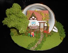 Tutorial. A House in a Teacup http://scarletsailsminiatures.blogspot.com/2011/09/tutorial-house-in-teacup.html