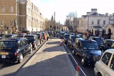 Thousands of cab drivers swamped Whitehall from about 2pm as a cacophony of car horns filled the air to signal the start of a 90-minute protest against transport bosses and minicab app Uber.
