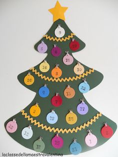 Cute and crafty advent calendar! I want to do this at school and have tongue twisters and chistes on the other side of each bauble! Cardboard Christmas Tree, Felt Christmas Ornaments, Diy Christmas Tree, Christmas Tree Decorations, Christmas Holidays, Christmas Countdown, Christmas Tree Advent Calendar, Christmas Arts And Crafts, Christmas Crafts