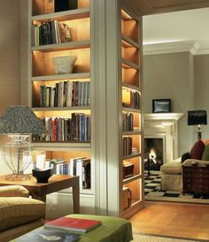 A beautiful built in bookshelf becomes a standout feature in the room thanks to extra lighting.