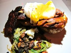 Duck confit with popover, frisee mushroom vinaigrette and poached duck egg at Muddy Leek, Culver City
