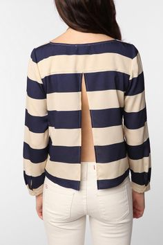 Love that from the front this comes off as a simple boat neck striped top but then you turn around and its like, bam! surprise.