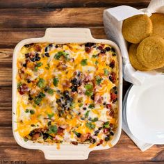 OVERNIGHT MEXICAN BREAKFAST CASSEROLE:  1 (14 oz) can black beans or pinto beans, drained and rinsed,    2 (10 oz) cans Rotel, drained (I use one mild green chile and one cilantro and lime),    1/4 tsp salt,    2 C shredded Colby Jack cheese blend,    2 slices thick cut bacon (cooked and crumbled),    5 large eggs,    1/2 C low fat milk,    1/2 T Chipotle Tabasco sauce,    8 corn tortillas
