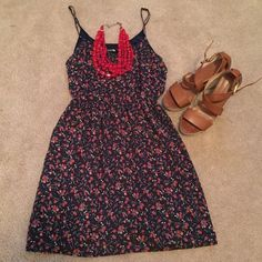 SALE! EUC Super cute & sexy floral dress! This dress is so sexy and cute at the same time! Has sexy spaghetti straps and an elastic waist that is super flattering. Cute design with a dark blue underlay! Excellent condition, just like new! Forever 21 Dresses