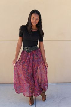Flowing sheer maxi skirt with a wide belt at the waist and a tucked in snug top. Perfect for a ladylike silhouette.