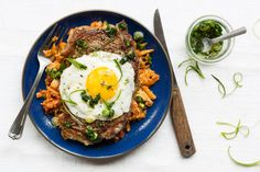 """When you're looking for a protein-rich meal, it's hard to beat the classic combination of steak and eggs. Chef Justine's cauliflower """"rice"""" makes for a terrific low-carb stand-in for standard rice—particularly cooked Spanish-style, with tomato and paprika, and seasoned with her easy, maple-sweetened scallion oil. #paleo #glutenfree #dairyfree #soyfree #lowcalorie"""