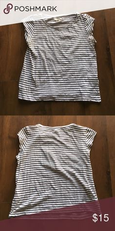 Madewell Marque Tee in Stripe PRODUCT DETAILS Cool and understated, this striped cotton-linen tee has a slim fit, a wide neckline and barely there sleeves. So perfect with high risers and flares.    More fitted, classic fit. Cotton/linen. Machine wash. Import. Item E1772. Madewell Tops Tees - Short Sleeve