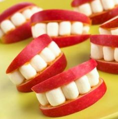 Great Halloween Idea.  Sliced apples, peanut butter and marshmallows