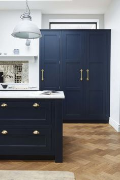 Herringbone wood floors with navy kitchen cabinets, marble counters and gold hardware for an old meets new kitchen design. Blue Kitchen Cabinets, Kitchen Diner, Kitchen Flooring, Gold Kitchen, Kitchen Handles, New Kitchen Cabinets, Blue Kitchens, Blue Cupboards, Trendy Kitchen