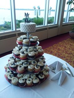A yummy tiered cupcake display with a simple cake atop, created by the talented Monona Terrace catering staff.