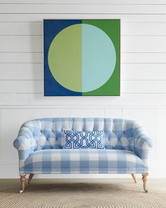 We adore this bold living room with its patterned button tufted couch, abstract art, and large jute rug. Bold Living Room, Coastal Living Rooms, Rugs In Living Room, Curved Couch, Navy Rug, Jute Rug, Upholstered Furniture, Chair Upholstery, Linen Bedding